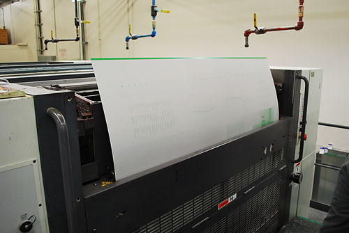 A printing plate being inserted into one of the towers.